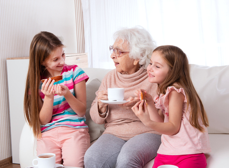 Great-grandmother with granddaughters