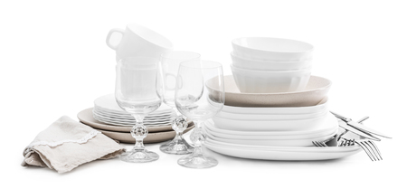 Set of white ceramic dishes and shiny glasses