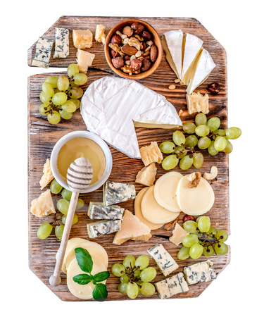 Cheese plate served with nuts and honey