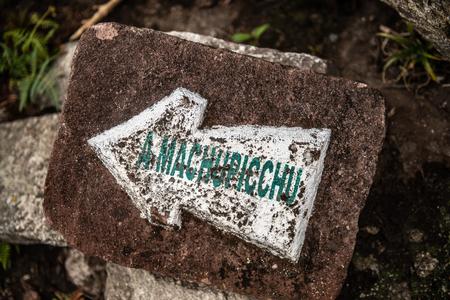 Old Macchu Picchu direction sign 스톡 콘텐츠