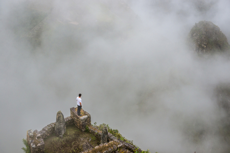 Man standing on the edge of mountain