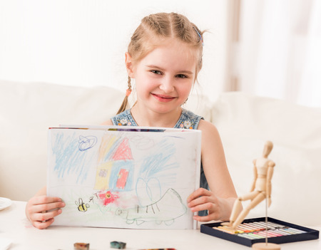Girl showing pastel drawing Stock Photo