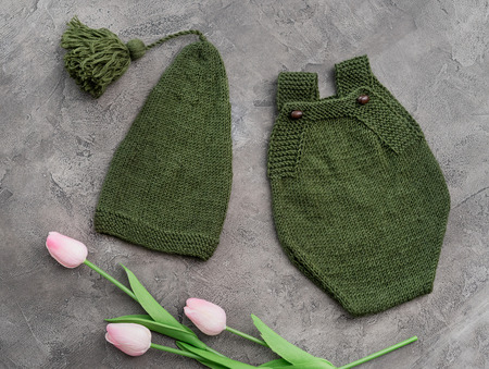 Composition of knitted suit and hat