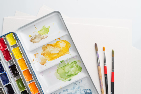 Stained paintbox with brushes