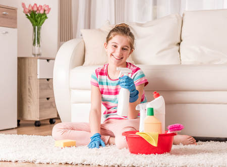 Girl with set of cleaning tools Stock Photo