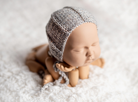 Mannequin of baby posing for photo Banque d'images - 121237585