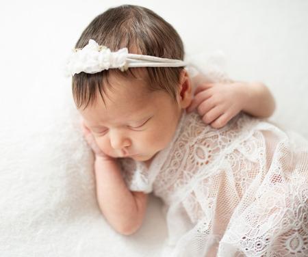 Newborn baby sleepin on tummy