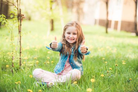 Small preteen girl enjoying summer days