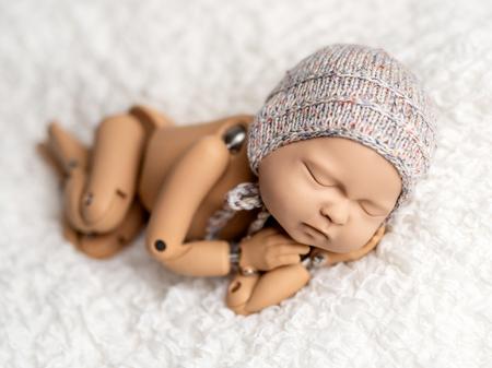 Mannequin of newborn for photo posing