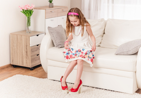 Child trying new heel shoes