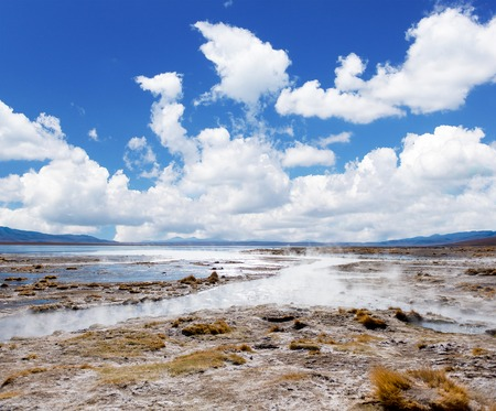 Sunshine surface covered with steam and geysers in Bolivia