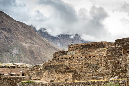 Old Incan castle from stone on mountain background