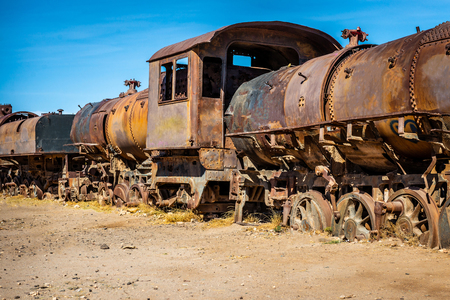 Old cemetery of abandoned steam-powered trains, Uyuni, Bolivia 스톡 콘텐츠 - 123033130