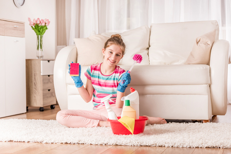 Girl with set of cleaning tools 스톡 콘텐츠 - 124175135
