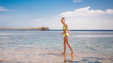 Teen walking at seashore 스톡 콘텐츠 - 124175133