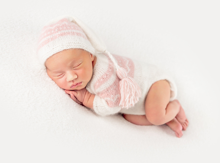 Baby girl in knitted suit and hat 스톡 콘텐츠 - 124175114