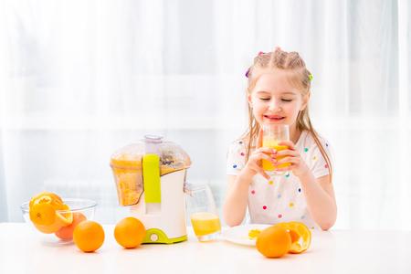 Girl enjoying glass of orange juice 스톡 콘텐츠 - 124175119