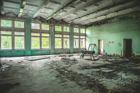 ruined school gym with sports equipment remains in Pripyat