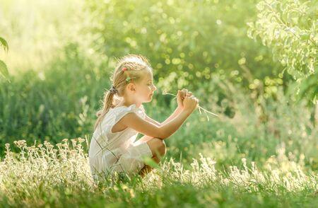 Little girl enjoying summer at meadow