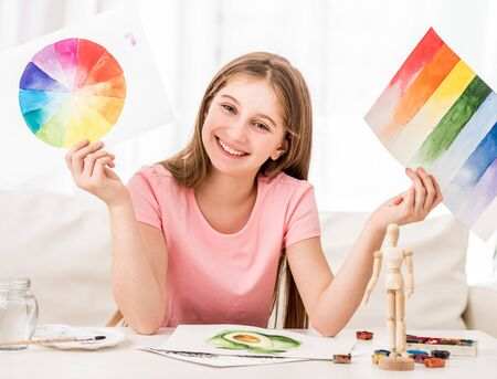 Girl showing her watercolor painted collection