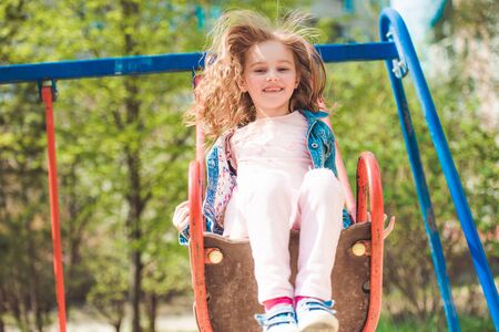 Small child on swing in park