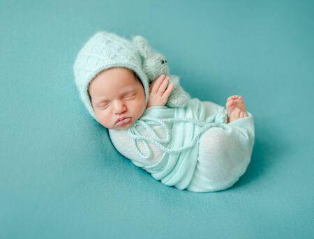 Newborn child sleeping in blanket