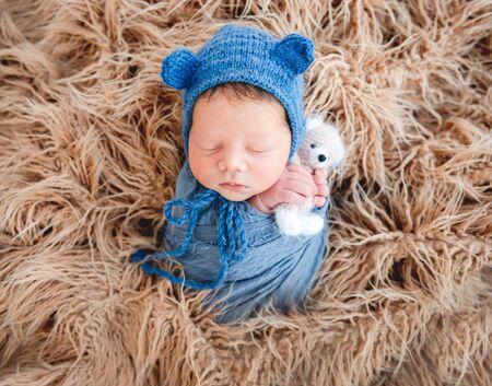 Newborn boy wrapped in a blanket