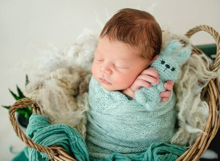 Newborn boy wrapped in a blanket Archivio Fotografico - 127754605