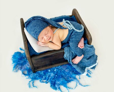 Cute boy in blue bonnet sleeping Stockfoto