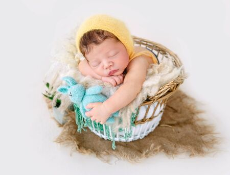 Newborn boy wrapped in a blanket Archivio Fotografico - 127754631