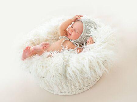 Cute newborn boy lying in a basket
