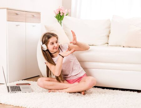Girl listening to music in the living room
