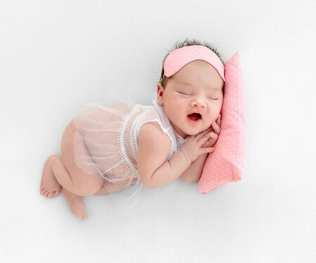 newborn baby sleeping on a little pillow