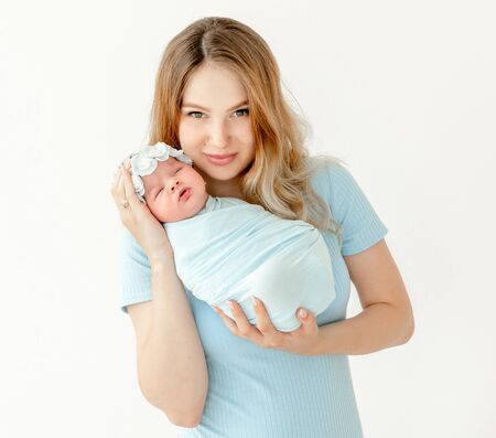 young beautiful mother holding a newborn daughter