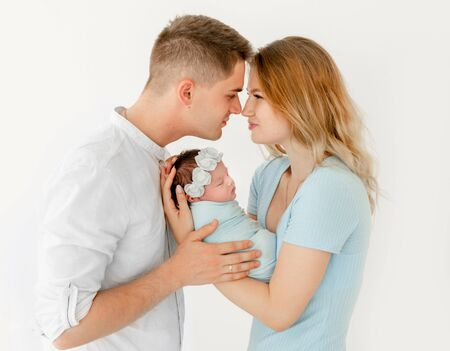 young beautiful parents holding a newborn daughter Reklamní fotografie