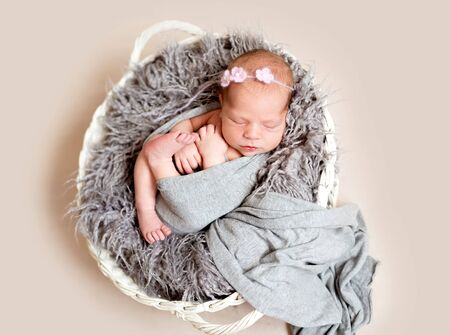 Newborn kid in nest bed