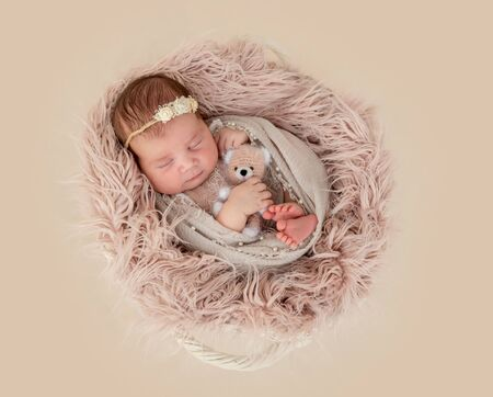 newborn girl sleeping sweetly 写真素材