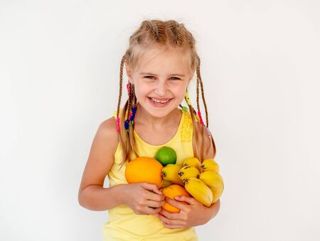 girl holding an orange with a straw for juice