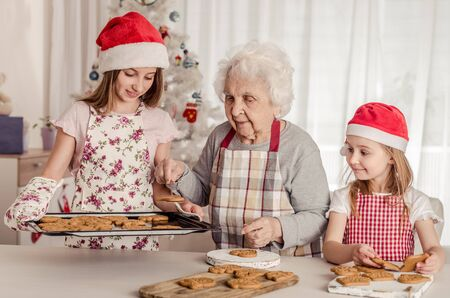 Grandmother with granddaughters baking cookies 写真素材