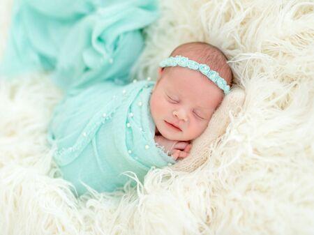 Sleeping newborn in blue headband Imagens