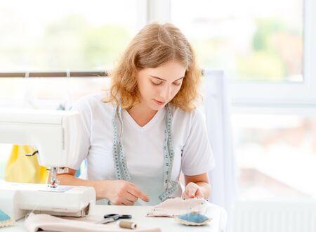 Dressmaker sewing new design by hands