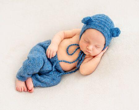 Cute boy in blue bonnet sleeping Stock Photo