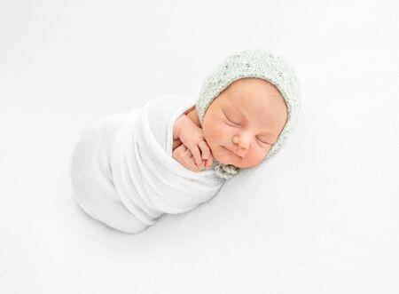 Newborn boy wrapped in a blanket Archivio Fotografico - 130854689