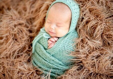 Smiling asleep newborn