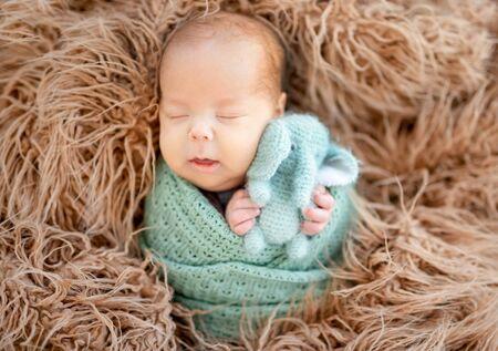 Newborn sleeping with toy