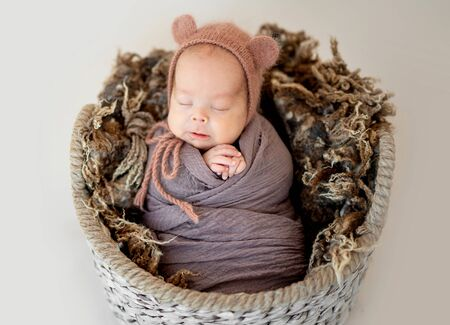 Lovely newborn in basket Stock Photo