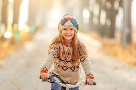 Smiling little girl on bicycle
