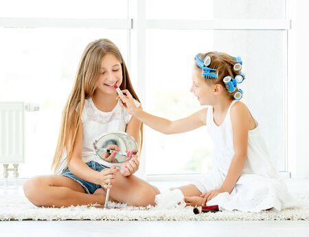 Girlfriends play doing makeup
