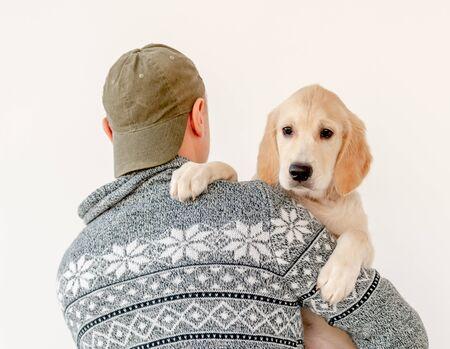 Man holding lovely dog Archivio Fotografico - 137413750