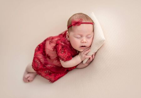 Cute newborn in red outfit